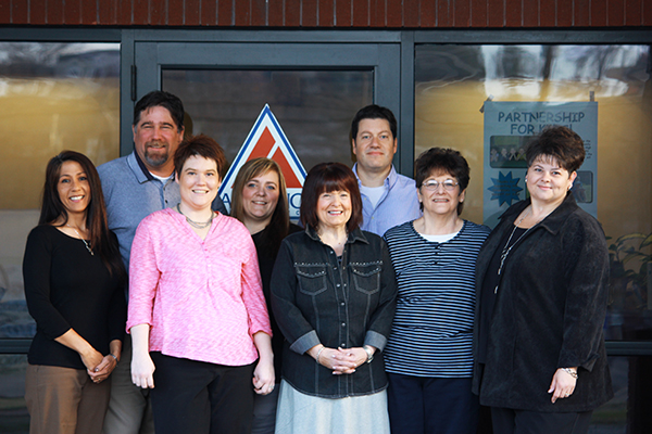 Back row, left to right:  Diana Zagelow, Chad Laird, Brandy Charlo, David Gomez. Front row, left to right:  Nikki Waham, Kathy Martin, Dee Solom and Pam Pearson.
