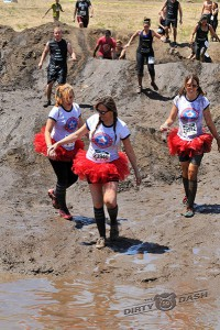 Trudging through the mud pit - Left to right:  Courtney Cairns, Stacy Cairns, and Heidi Green.
