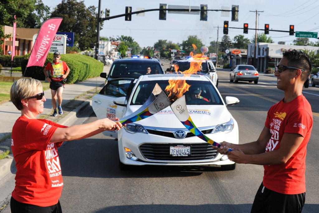Jenny Martin receiving the Flame of Hope at the beginning of Alliance Title's leg of the URAA in Boise, ID.