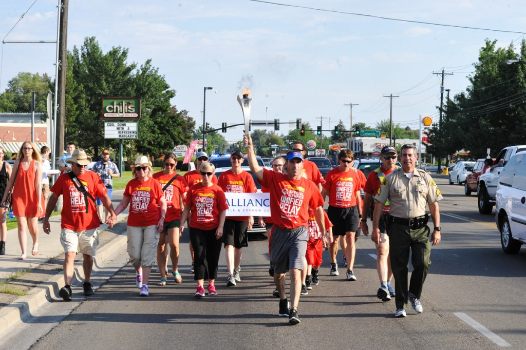 Ron Jantzen carrying the torch in the URAA through Boise, ID.